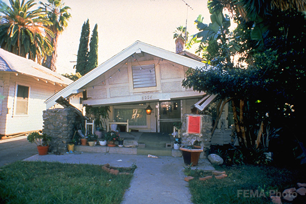 """Image: This house sustained severe earthquake damage during the Southern California Northridge earthquake in 1994. The damage was so extensive that it was """"red-tagged,"""" which means the structure is too dangerous to inhabit. Photo credit: FEMA"""
