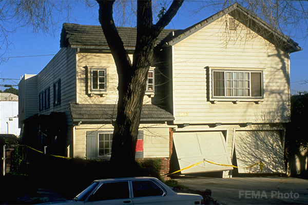 This house with a living space over the garage shows damage sustained during the Northridge earthquake. Photo credit: FEMA