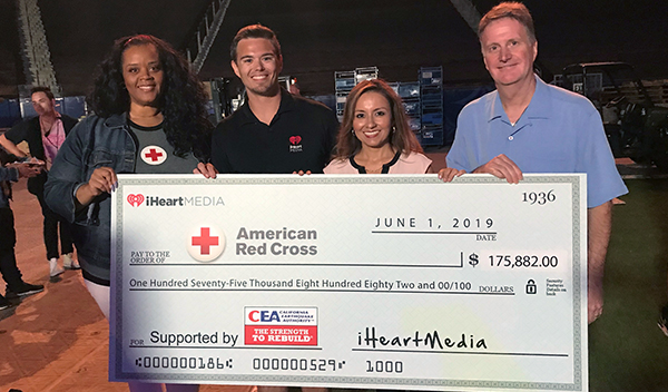 Before the official on-stage check presentation, displaying the amount raised during this year's Get Prepared, California! Auction, nearly $176,000, bringing the eight-year total to more than $1.4 million. From left: Amira Seaboch, American Red Cross Los Angeles Region; Chad Preacher, iHeartMedia; Pamela Diaz, California Earthquake Authority; and Chris Nance, California Earthquake Authority.