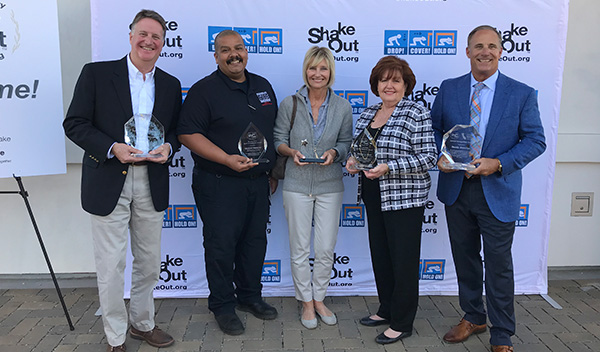 Chris Nance, CEA; Michael Ramirez, San Bernardino County Fire Office of Emergency Services; Bunni Benaron, The Hero In You Foundation; Margaret Vinci, Caltech; Dean Reese, Ready America, receive awards during the 10th Anniversary Ceremony of the Great California ShakeOut in Long Beach, CA on Nov. 1.