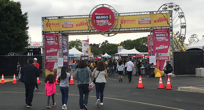 Fans entering the Wango Tango 'Village' area, prior to the main music event, which is considered one of the largest concerts in the country.
