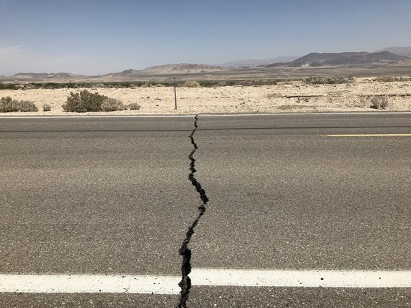 Ground movement caused a crack and offset the painted lines on Highway 178 near Ridgecrest.
